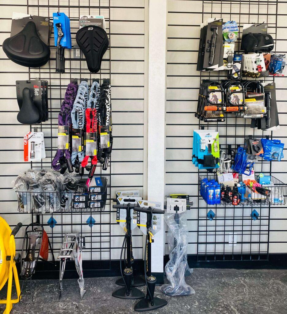 bike accessories hanging up inside of a bike shop
